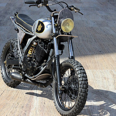 Custom DR650: Bikes and Boards Unite for a Sweet Ride