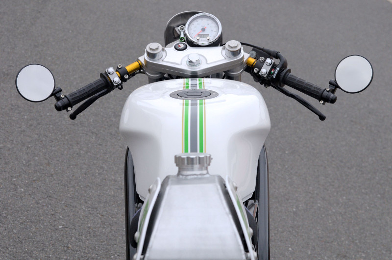 Footpegs are from Tarozzi.