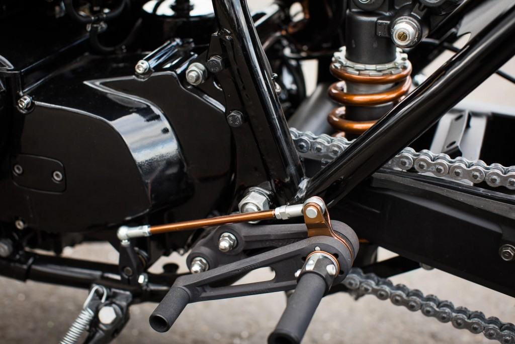 The rear sets are Tarozzi that have been selectively powder coated in a copper color and anodized flat black.