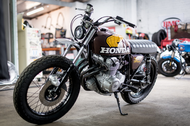 """Honda CB400F Scrambler The Honda CB400F Super Sport -- aka Honda 400 Four -- has been called Japan's first real sportbike. In an era when many riders were more interested in straight-line speed and quarter-mile times, the 400F had low handlebars, rear-set footpegs, and a lightweight race-style exhaust -- possibly the most beautiful pipes ever to debut on a stock motorcycle. While it didn't have the outright power of its two-stroke rivals, it was more refined and sophisticated, with Honda's first six-speed transmission and that 408cc, 37-hp SOHC inline four. Says Motorcyclist: """"It was the sleek, purposeful, lithe, and downright sexy 400 Four that best exemplified Japan's move toward Euro-inspired sporting machines, bikes like Ducati's 750SS and BMW's R90S."""" Honda CB400F Scrambler Enter Francesco Tutino, an Italian-born motorcycle professional who's been in the industry for more than twenty years. In 2012, he moved to Brisbane, Australia, and a year later, a bad accident led him to him to the custom world: """"My first real experience on custom bikes began in 2013 after I've badly crashed my 1993 Harley Softail and built my first cafe racer out of it."""" Honda CB400F Scrambler In 2018, he opened his own workshop, Francis Von Tuto Moto Works, based in the Fortitude Valley. The bike you see here is a '76 Honda CB400F Super Sport, which Francesco bought from an older man who'd done a restoration years ago, before hanging up his helmet. Already having three bikes with clip-ons in the garage, Francesco had a more versatile build in mind: """"Rather than building another cafe I wanted something more versatile, nothing too extreme but definitely a bike that can jump the kerb without damaging the sump or the headers or take on some light trails with peace of mind."""" Honda CB400F Scrambler We especially love the """"Regalorita"""" influence on the build -- meaning """"regularity"""" in Italian, Regolarita was an important discipline in the ISDT championships of the 1970s, and many factories create"""